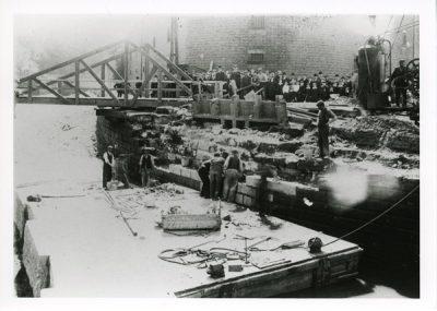 Workmen Building canal wall