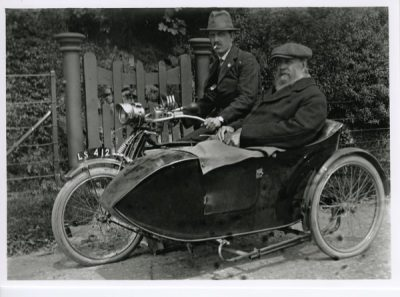 Motor cycle and side car. -