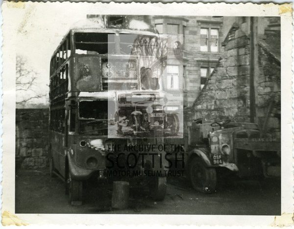2 fire damaged buses